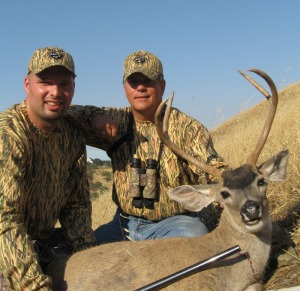 kevin and lt col hammak celebrate his blacktail buck cropped