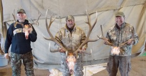 Dave McKeller, Rick Leas and I posed with our antlers in Rocky's barn.