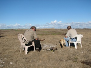 In this photo from 2010, Rob and Wes are plucking ducks facing the Mayberry Marsh as it was in 2010.