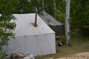 Henry's comfortable camp was tucked away in an aspen patch at about 8,500 feet above sea level.