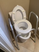 toilet seat riser with arm rests